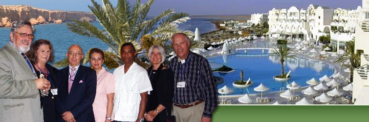 Board of Directors in front of resort image